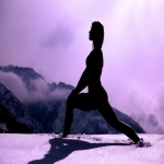 silhouette woman stretching winter mountain